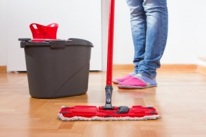 floor cleaning - Woman cleans the hardwood floor