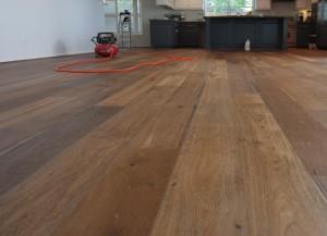 Hardwood floor cleaning in process