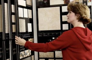 Woman in the flooring store deciding for new floor