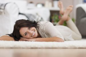 Woman laid down on the well maintain carpet floor