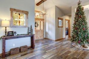 Clean hardwood floor with Christmas tree