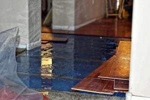 flooded home by winter storm Uri
